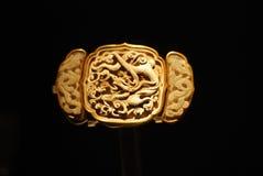 Sash taohuan with greenish white jade. Mounted in gold Stock Photo