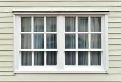 Sash window. Old sash window and weatherboarding on house Stock Photos