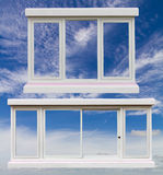 Sash windows white cloud sky. Royalty Free Stock Photo