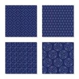 Sashiko motifs. Set. Seamless abstract textures. Four simple textures. Japanese sashiko motifs. Abstract Seamless patterns. White stitches on the indigo blue Stock Photos