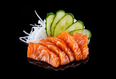 Sashimi σολομών πέρα από το μαύρο υπόβαθρο Στοκ Εικόνες
