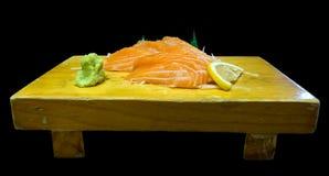 Sashimi σολομών που απομονώνεται στο μαύρο υπόβαθρο Στοκ Εικόνες