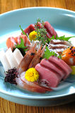 Sashimi. Japanese sashimi on a blue plate Royalty Free Stock Image