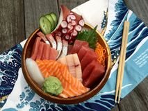 Sashimi Arrangement in a wooden bowl. This is a sashimi arrangement in a wooden bowl. It called as Sashimi Donburi in Japanese Stock Images