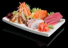 Sashimi assortment. Sashimi seafood assortment on large triangle plate royalty free stock image