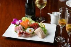 Sashimi avec du vin blanc images libres de droits