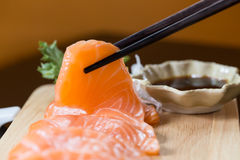 Sashimi with chopsticks, Japanese food Royalty Free Stock Photos