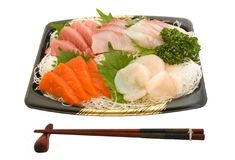 Sashimi and chopsticks on white background Royalty Free Stock Images