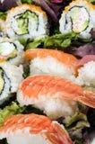 Sashimi del sushi con los rodillos de California Fotografía de archivo libre de regalías