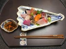 Sashimi different raw sea food Hakone Japan. Sashimi with different raw sea food thinly sliced. Served at a ryokan. Hakone, Kanagawa, Japan stock photos