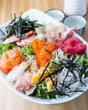 Sashimi don with sake. Authentic Japanese Sashimi don serving with sake Royalty Free Stock Photo