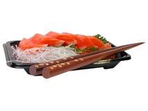 Sashimi e bacchette di color salmone Immagini Stock