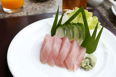 Sashimi of fresh tuna (Seafoods Sushi) on white dish. Sashimi of fresh tuna (Seafoods Sushi) on white dish in restaurant,Traditional of Japanese Food Stock Images