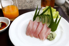 Sashimi of fresh tuna (Seafoods Sushi) on white dish. Sashimi of fresh tuna (Seafoods Sushi) on white dish in restaurant,Traditional of Japanese Food Royalty Free Stock Image