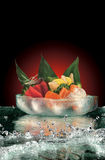 Sashimi on ice with water. Bowl of Japanese sashimi on ice with water splashing Stock Photography