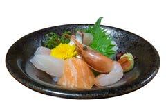 Sashimi on irregular shape plate isolated on white Royalty Free Stock Image