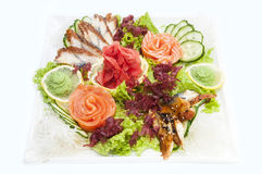 Sashimi. Japanese cuisine sashimi with vegetables and fish in a restaurant royalty free stock image