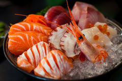 Sashimi is a Japanese delicacy consisting of very fresh raw meat or fish sliced into thin pieces Stock Photo
