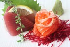 Sashimi 4. Japanese sashimi set consisting of salmon, tuna, hamachi, radish slices, and wasabe Stock Photo