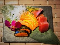 Sashimi mix types of fish. On stone plate in Japanese restaurant, fusion and modern Japanese food concept Stock Photo