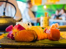Sashimi mix types of fish on stone plate. In Japanese restaurant, fusion and modern Japanese food concept Stock Photography