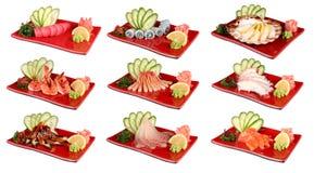 Sashimi na czerwonych talerzach Tradycyjny Japoński naczynie świeży owoce morza Na bia?y tle zdjęcie royalty free