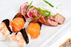 The sashimi plate with shrimps, salmon and tuna. The different sashimi plate with shrimps, salmon and tuna Stock Photo