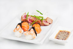The sashimi plate with shrimps, salmon and tuna. The different sashimi plate with shrimps, salmon and tuna Royalty Free Stock Photo