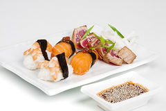 The sashimi plate with shrimps, salmon and tuna. With soy Royalty Free Stock Images