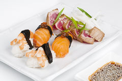 The sashimi plate with shrimps, salmon and tuna. With soy Stock Image