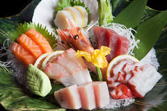 Sashimi Platter. Fresh Japanese Sashimi platter with prawn, scallop, tuna, octopus and salmon on ice stock images