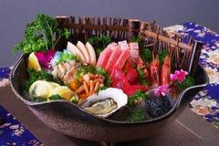 Sashimi Platter. Fresh sashimi with shrimp, scallops, tuna, octopus and salmon royalty free stock images