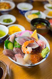 Sashimi raw fish seafood on rice Royalty Free Stock Images