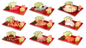 Sashimi on red plates. Traditional Japanese dish of fresh seafood. On a white background royalty free stock photo
