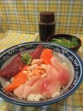 Sashimi and rice. Salmon, tuna and fatty tuna with rice, japanese Stock Photography