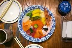 Sashimi rice. In the restaurant royalty free stock image