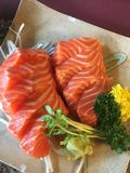 Sashimi salmon. Eating sashimi salmon with wasabi Royalty Free Stock Images