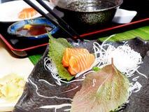 Sashimi - Salmon Fish. A plate of Sashimi served with raddish Stock Photography