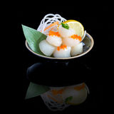 Sashimi with scallop in a black plate. On a black background wit Stock Photo