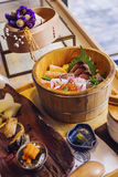 Sashimi. The sashimi with the sea urchin and the sace in the bowl stock images