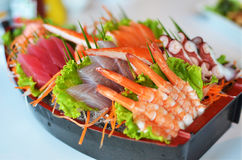 Sashimi seafood set in a boat blow Royalty Free Stock Photo