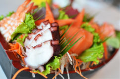 Sashimi seafood set in a boat blow Royalty Free Stock Photos