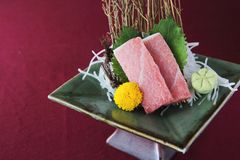 Salmon sashimi set on a plate. In close up stock images