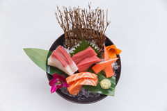 Sashimi Set Include Raw Salmon, Raw Hamachi Japanese Amberjack, Raw Maguro Bluefin Tuna and Kani Crab Stick. Stock Photography