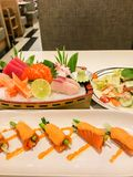 Sashimi and spicy salmon roll in Japanese restaurant royalty free stock images