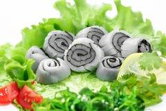 Sashimi squid, vegetables, lettuce, tomato, squid Royalty Free Stock Image