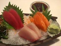 Sashimi sur la glace Photographie stock libre de droits