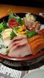Sashimi Sushi Fresh Seafood Platter at Japanese Restaurant. With an assortment of fish - Maguro tuna - Hamachi yellowtail - Sake salmon - Ika squid - Uni sea stock images