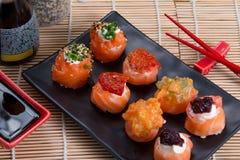 Sashimi and sushi rolls. Japanese food background close diner Royalty Free Stock Photography