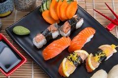 Sashimi and sushi rolls. Japanese food background close diner Royalty Free Stock Images